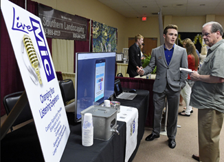 LOOKING TO THE FUTURE Looking to the future: CEO Program students show off hard work at trade show